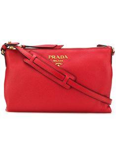 22524cdca161 PRADA PRADA PEBBLED ZIPPED CROSSBODY - RED.  prada  bags  shoulder bags   leather  crossbody