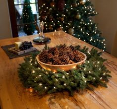 Inexpensive Holiday Centerpiece - A evergreen wreath (whether made from free clippings from where Christmas Trees are sold or a store bought artificial one) surrounding a Bowl of Pine Cones, and some LED lights (easy to turn on and off).