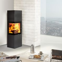 Austroflamm Slim 2.0 LEFT wood burning stove     Up to the next level - our Slim 2.0 has landed! Tall, slender and equipped with a fancy corner door. The new stylish Slim can now also be fitted with the Heat Memory System for heat storing. With its square base, the Slim 2.0 also fits perfectly into corners.