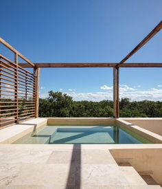 BAI-HA spans three storeys and a rooftop with views of the jungle canopy and ocean. The resort is located in Aldea Zamá, southern Tulum, about 100 metres from the area's main beachfront. Apartment View, Apartment Interior, Roof Garden Plan, Natural Architecture, Apartment Complexes, Rooftop Pool, Holiday Resort, Swimming Pool Designs, Swimming Pools