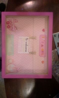 Shadow box picture frame for a baby girl