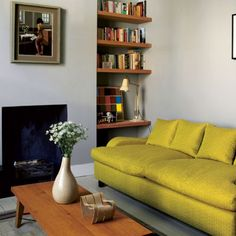 Calm living room  Grey walls, painted floorboards, wood pop of colour
