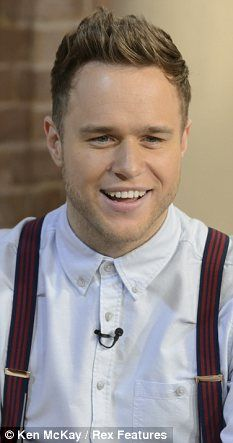 Sitting pretty: Olly Murs is sitting pretty at the top of the singles and the album charts and his hairs top of our charts too!