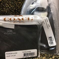 """NWT & Packaging Mini Bennett & Corner Zip Wristlet % Authentic Guaranteed!  Brand new w/ tags, in store packaging! Coach crossgrain leather - Coach Mini Bennett  Satchel in Silver & Pewter (9""""x 6.5""""x 5"""" with 4"""" handle drop, 23"""" shoulder or crossbody strap), inside zip, cell phone & multifunction pockets, top zip closure & Coach Corner Zip Small Wristlet Wallet in Silver & Gunmetal (6.5""""x 4""""x .25"""" with 6"""" wristlet strap), inside card slip pockets, top zip closure. LKing for more Coach items…"""