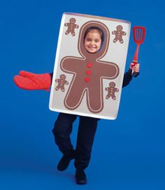 Gingerbread Man cookie sheets with the face cut out for a photo op