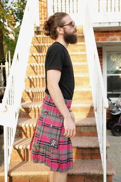 The Ailsa Pink Tartan Kilt lets you get creative and have a bit of fun with your kilt wearing so that you can shake things up a bit. This kilt features a light gray background upon which the hot, neon pink color can stick out and catch the eye immediately.  #AilsaPinkTartanKilt #AilsaPinkTartan #Kilts #kiltsfromscotland