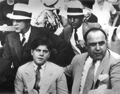 Capone and his son Sonny .The photo was taken on September 9th 1931, at Comiskey park.  The game was between the Chicago white sox and the Chicago cubs. It was a game to raise funds for charity. The cubs won 3-0.