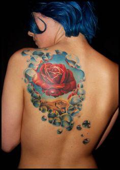 Beautiful tattoo of Meditative Rose by Salvador Dali
