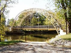 Dunn's Bridge, Porter County, Indiana;  over the Kankakee River;  built in 1895, renovated in 2003;  now a pedestrian bridge;  photo by Indiana Landmarks, via Flickr