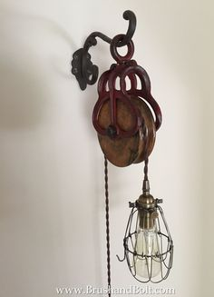 Barn pulley light with vintage style twisted cloth cord, solid brass fixture and trouble light cage. Rarely seen red hay pulley makes this barn pulley light a real beauty. www.brushandbolt.com