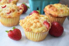 Strawberry Rhubarb Muffins are the perfect summertime breakfast. They are bright, slightly sweet, and melt in your mouth!