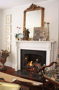 Such a pretty mantel - I love that it doesn't look staged, it looks collected. Over time. With family treasures.