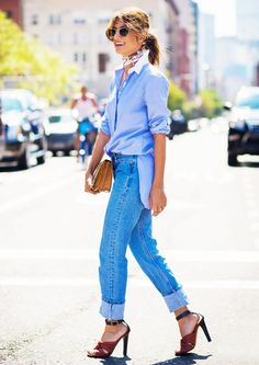 A boyfriend-inspired button-down shirt is worn with cuffed jeans, ankle-strap sandals, a neutral clutch, and a neckerchief