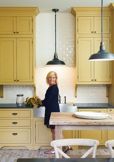 yellow, painted cabinets, subway, pendant lighting