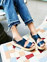 Sun Dried Flatform Sandal | Flatform sandals with strappy cracked leather uppers and adjustable ankle strap for an easy onoff. Classic wooden bottoms.