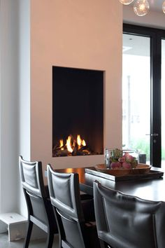 Love the idea of a nice fire place at the end of a dining table