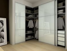 Modern Closet with Frosted glass sliding closet doors, Bamboo flooring, Modu…