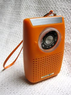 Bright colors like this orange Passport radio became popular about 1970.