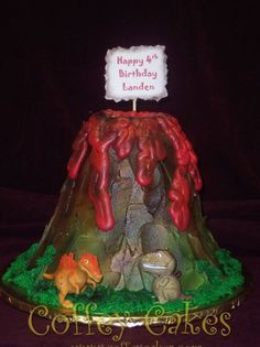 Volcano cake with cute dinosaurs that roar and light up when you push a button. The cake is 4 single layers tall and has a cup in the middle to put dry ice in for a smoke effect.