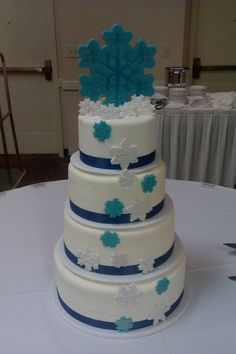 Cake #3 from Buttercream in St Paul - flowers or something else cute instead of the snowflakes since we're not having a winter wedding