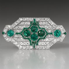 Art Deco Antique Emerald & Diamond Brooch Pin Solid Platinum. This amazing Art Deco antique brooch pin is crafted of solid platinum and features natural emeralds and diamonds and is in very good condition.
