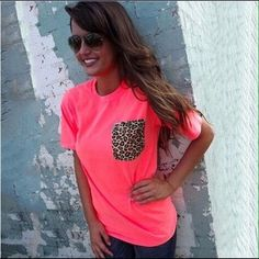 Coming Very Soon! Hot Pink Leopard Pocket Tee Wonderfully girly, wonderfully casual. Can't go wrong, it makes the outfit. Pair with any basic pair of shorts or your fave ripped jeans for an ultra casual look. Or be extra fun & funky and pair it with a flared out skirt or spice up a pencil skirt with this colorful piece!  Do you. Tops Tees - Short Sleeve