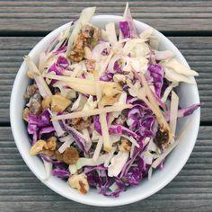 The Filling Fall Salad That Can Help You Detox. Ingredients: Savoy cabbage, red cabbage, fuji apple, red onion, walnuts, golden raisins, apple cider vinegar, cayenne pepper, Greek Yogurt, agave, fennel seeds, sea salt