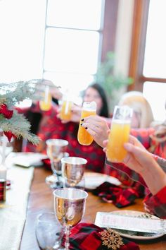 girls-in-flannel-pjs-toasting-mimosas http://itgirlweddings.com/flannel-themed-bachelorette-party-weekend/