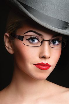 Women's Modern Art, eye glass frames by Modern Optical International; A-318 modern art frame.  Beautiful stainless steel sophisticated stylish frame available in brown, purple/black, and rose/burgundy colors.  Love the red lips and makeup on this model with this beautiful frame!
