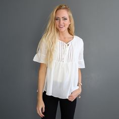 "Soft woven embroidery top with v-neck, and tie front closure  Approximate bust measurement:  Small -   36""          Medium - 38""          Large - 40""  Approximate length:  Small - 24""  Medium - 24.5""  Large - 25"""