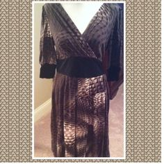 SNAKE PRINT SURPLICE TOP DRESS - SIZE SMALL The Snake Print Jersey Knit dress is in beautiful tones of brown, black, and desert tones. The colors remind me of a Copperhead snake. V neck with matching trim on sleeves and at tie back waistband; comes with a side zipper.  Soft shirring to enhance the bust and around the waist, complete with a full skirt. Available in S,M, L;  S(2-4) M (6-8) L (10-12)  THIS LISTING IS FOR A SIZE SMALL   No holds or trades; price is firm unless bundled. Ryu…