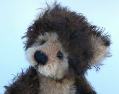 Little David, is a fun Teddy bear. His fur is semi curly two tone Mohair. He is fully jointed and has glass eyes.