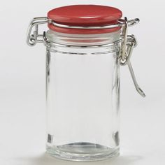 WorldMarket.com: Spice Jars with Red Ceramic Lids, Sets of 6 for $5.94. Not sure if this has a shaker lid or not, or what the volume is.