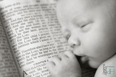 newborn photography, baby with Bible photo. Also it would be cute to buy a paper on the day the baby is born and take a newborn picture with it!