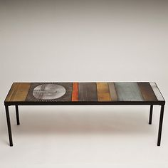Roger Capron - Coffee table. Top with Glazed lava tiles decorated with a sun face. Vallauris-France, circa 1960    http://www.galerieriviera.com