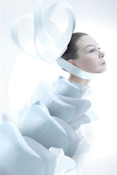 Futuristic avant garde couture design oversized hair bow and sculpted blossom collar is the unique work of photographers and stylists: Alexandra Zaharov and Ilya Plotnikova - pinned by RokStarroad.com
