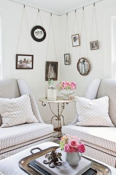 Family photographs instantly add warmth and personality to your home. Take them out of the attic, off your computer, or out of the infrequently viewed albums on your bookshelves, and enjoy them every day. #livingrooms #homedecor #southernliving