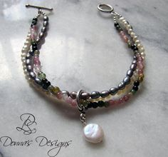 """7.5"""" Multi strand bracelet made of pearls, multicolored tourmaline, sterling silver toggle."""
