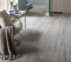 Kitchen Flooring Ideas - Complete your Light Grey Greenwich kitchen with light grey oak effect flooring. For more inspiration, visit Howdens.