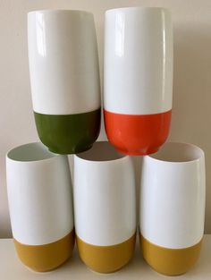 60s 70s vintage retro Set of five tall thermos insulated ware plastic beakers in retro mustard, green and orange. Great for your kitchen or camper. Approx 17cm high. Some age related wear a few marks as shown in the photo & one slight discoloured in the inside at the bottom. We only ship within the UK. If you are an international buyer and want to make a purchase please use the Ebay Global Shipping Programme. Any questions please ask. Pl...