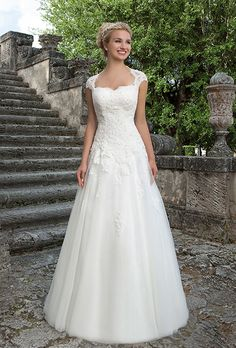 Sincerity Bridal. The lace Queen Anne detachable jacket, sweetheart beaded lace bodice and full tulle skirt of this ball gown create a classic, princess look.