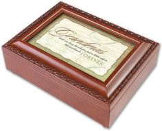 Grandmas Forever Woodgrain Music Box Plays Wonderful World by Cottage Garden. $29.99. Easily Personalize With Your Own Photos And Messages. Makes A Perfect Gift Or Family Keepsake.. Beautiful Woodgrain Finish.. Plays Wonderful World. This beautifully trimmed Music Box / Jewelry Box makes the perfect gift. The Sankyo brand musical movement is enclosed in glass for an added touch of luxury. Use the photo opening to add your own special touch of personalization.