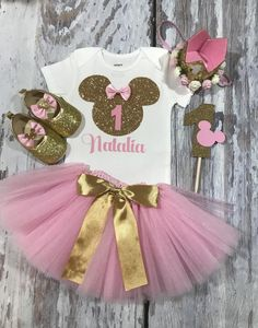 Dress your princess with this beautiful custom made Minnie Mouse headband, onesie, tutu, cake topper and matching shoes. Perfect for any age, a cake smash or first Disney trip! This one of a kind Minnie Mouse inspired design is non flaky and is made using Minnie Mouse Birthday Decorations, Minnie Mouse Birthday Outfit, Minnie Mouse Headband, First Birthday Outfit Girl, Minnie Mouse Theme, Pink Minnie, 1st Birthday Girls, Mouse Outfit, Birthday Ideas