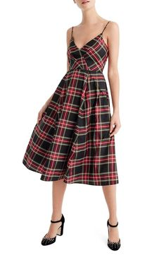 This dress screams 'holidays' with a polished silk blend, flattering A-line silhouette and a festive Stewart plaid.
