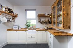 Wren Kitchens Shaker Alabaster Timber - This square kitchen has been completely revamped by the traditional charm of this Shaker design. We love the Belfast sink and oak worktops!