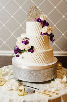 Featured Photographer: Natalie Franke Photography; Stunning three tier white textured wedding cake topped with white and purple flowers