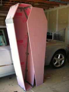 Halloween- DIY ~ Coffin using only foam board, duct tape, and paint. Use pencil to carve wood grain pattern before painting.