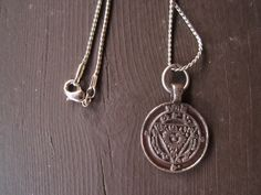 Wax Stamp Pendant Necklace. $12.00, via Etsy.