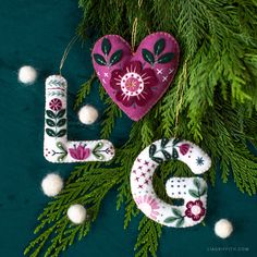 Felt Monogram Ornaments with Gorgeous Embroidery - Lia Griffith - - Anyone with beginner embroidery skills or higher can make these felt monogram ornaments! Craft them for yourself or as a personalized Christmas gift. Ornament Pattern, Felt Ornaments Patterns, Letter Ornaments, Unicorn Ornaments, Diy Ornaments, Beaded Ornaments, Glass Ornaments, Primitive Christmas, Handmade Christmas