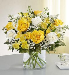 Full of sunny cheer, our brightly-colored bouquet makes the kind of surprise that will leave them smiling. Blooms like yellow roses, Peruvian lilies, white carnations and assorted greenery are loosely gathered inside a clear cylinder vase. The perfect summer flowers for delivering warm sentiments to someone who means so much. Easter Flower Arrangements, Easter Flowers, Mothers Day Flowers, Beautiful Flower Arrangements, Flower Vases, Beautiful Flowers, 800 Flowers, Types Of Flowers, Fresh Flowers